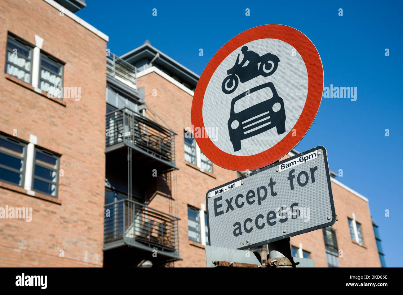 Road sign showing no entry for cars or motorcycles except for access - Stock Image