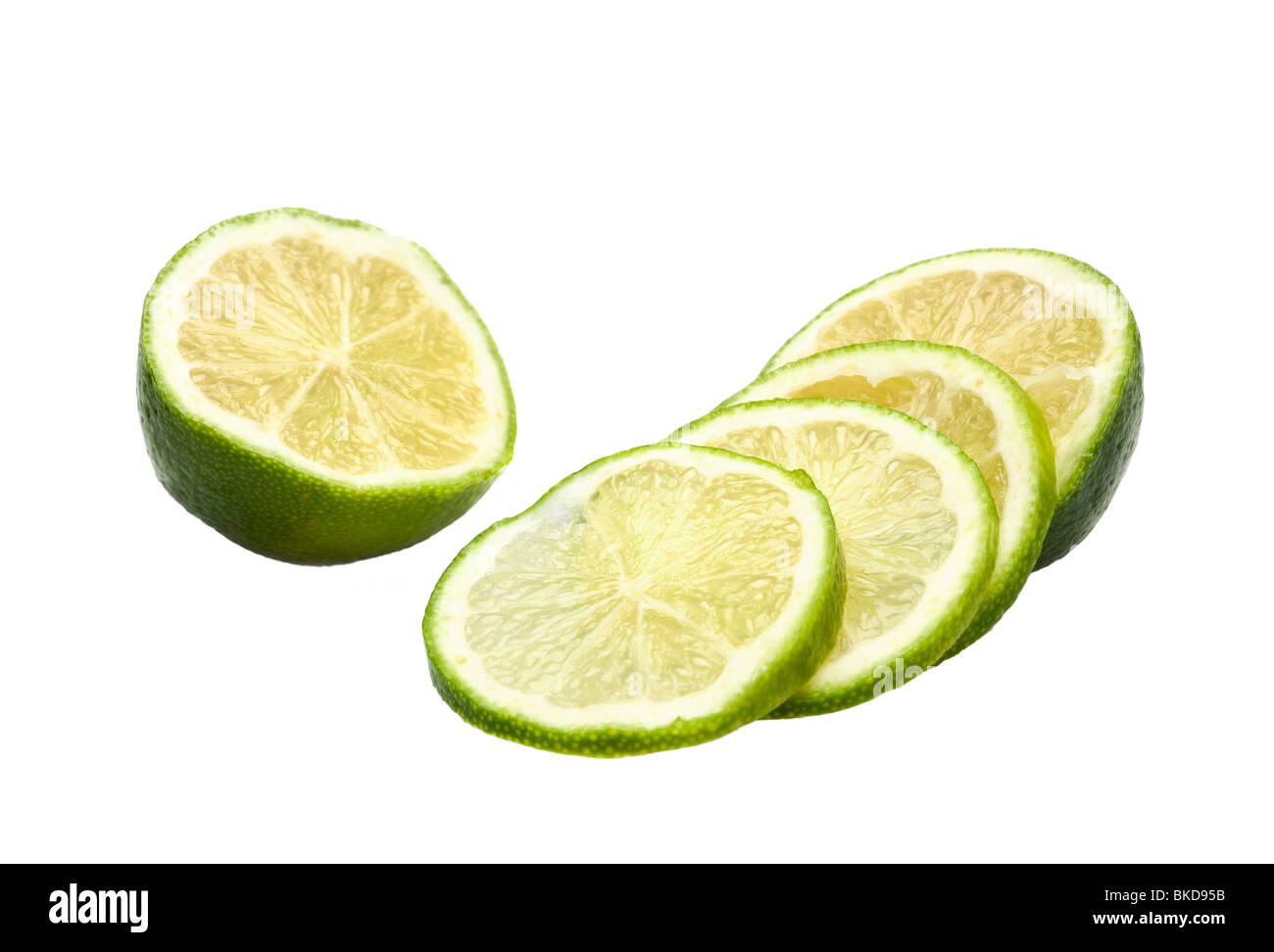 Limes whole and sliced on white - Stock Image