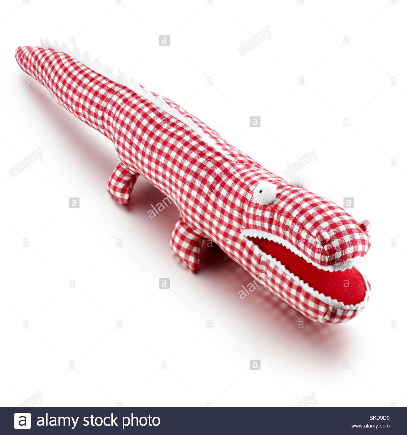 gingham stuffed crocodile - Stock Image