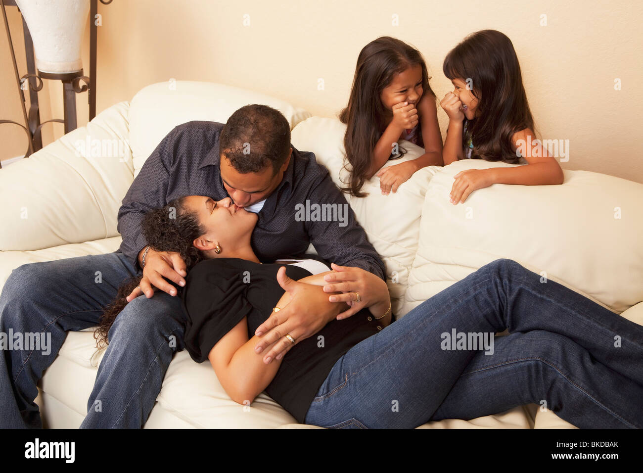 Girls Watching Their Parents Kissing - Stock Image
