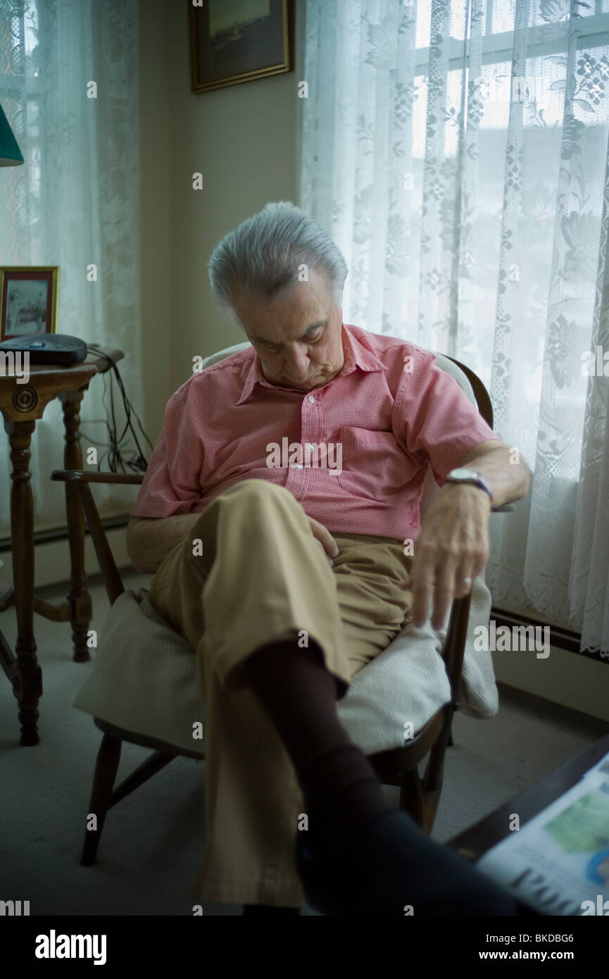 Old man sleeping in living room chair Stock Photo - Alamy