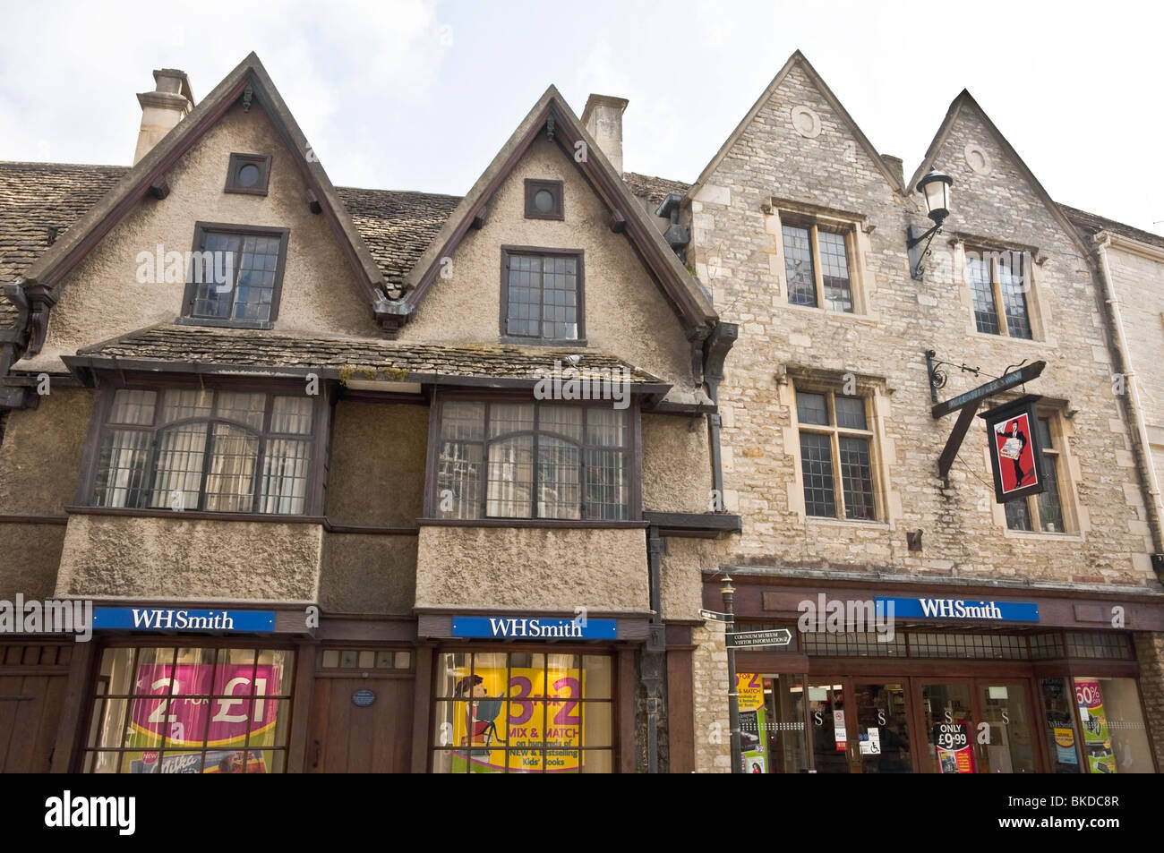 WH Smith store within old stone period buildings in the market town of Cirencester, Cotswolds, Gloucestershire, - Stock Image