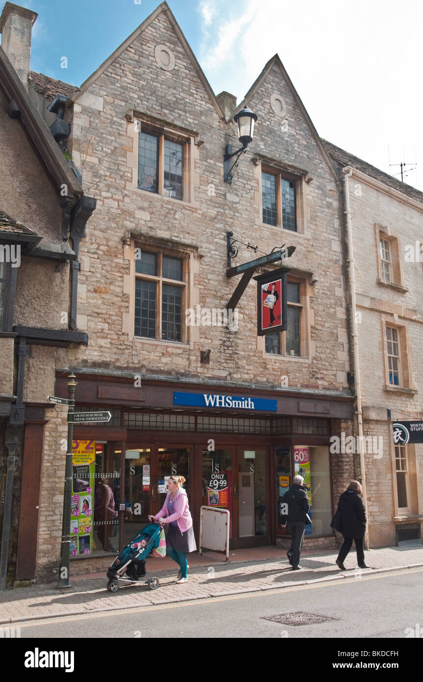 WH Smith store within old period stone buildings in the market town of Cirencester, Cotswolds, Gloucestershire, - Stock Image