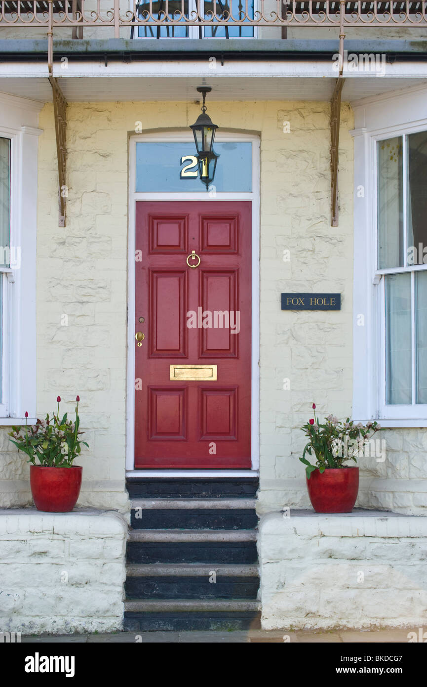 Red Front Door Number 21 With Fanlight Of Period House With Steps