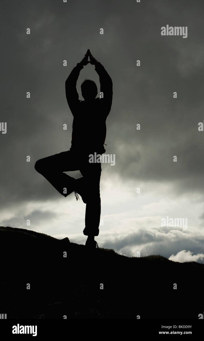 Man In Vrksasana Position, Alaska, Usa - Stock Image