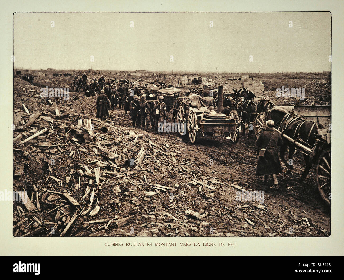 WWI supply convoy heading for the battlefield through bombarded terrain in West Flanders during the First World - Stock Image