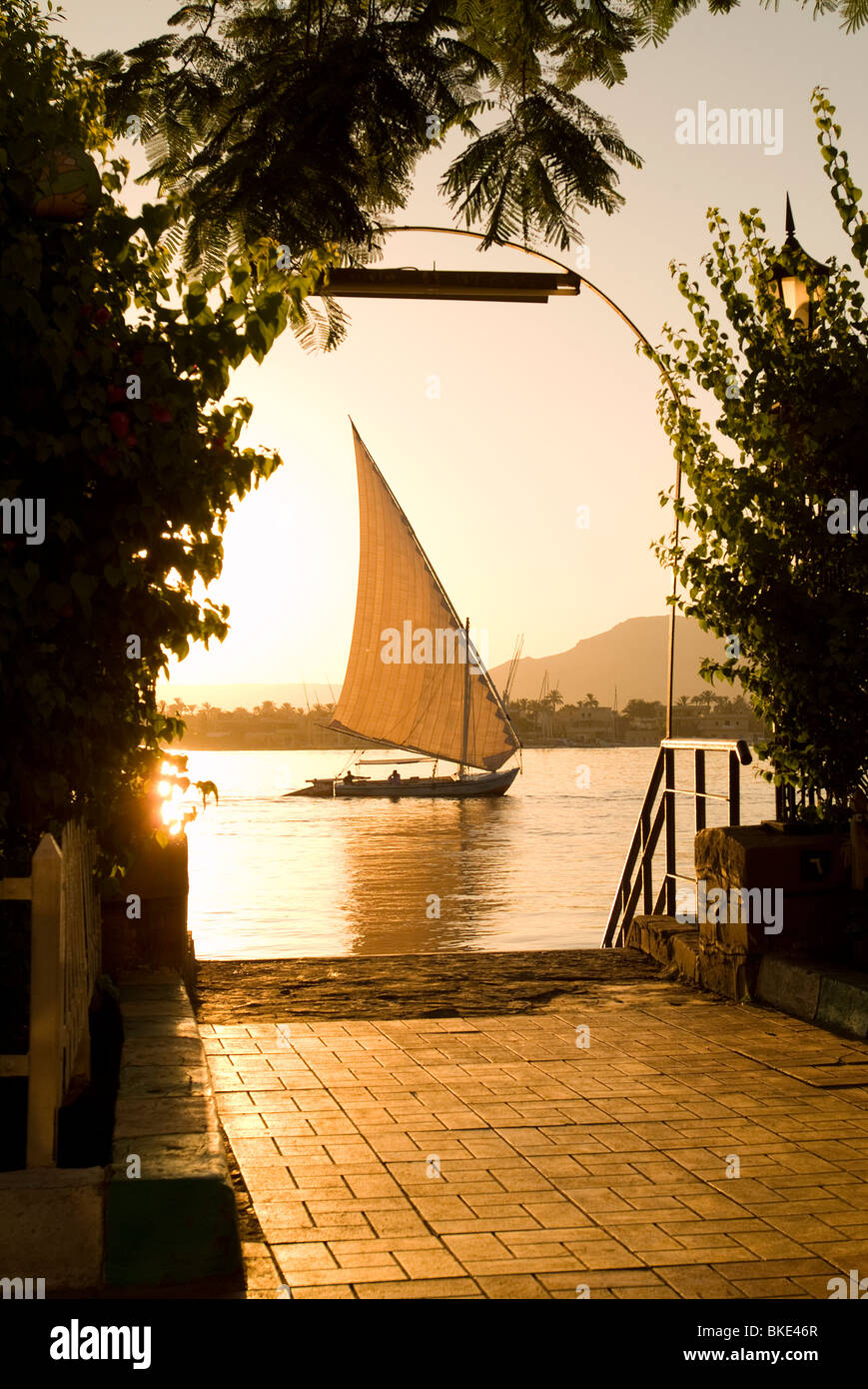 Sunset on the Nile with Felucca, Luxor, Egypt - Stock Image
