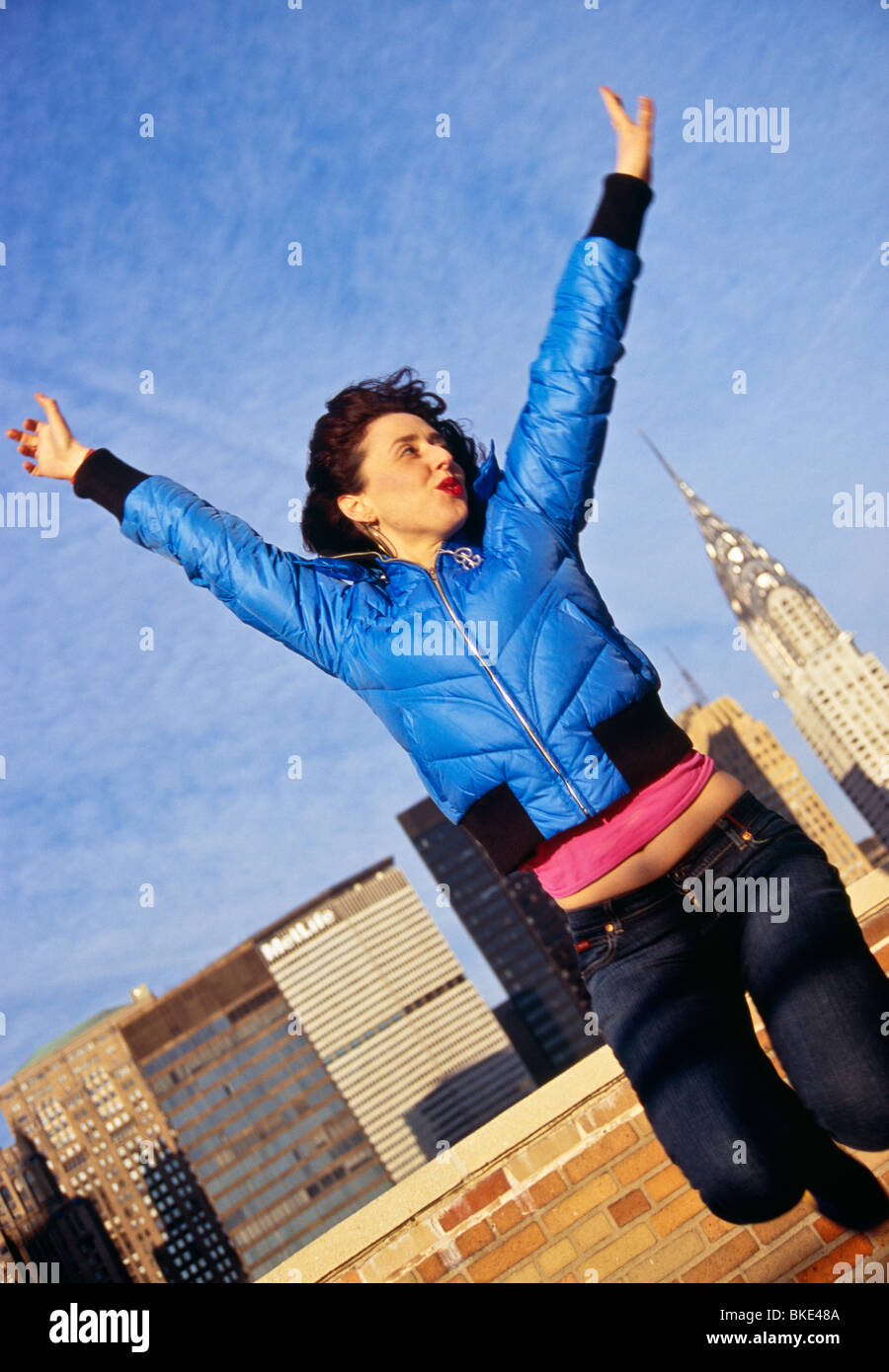 'Young Woman Jumping for Joy ' - Stock Image