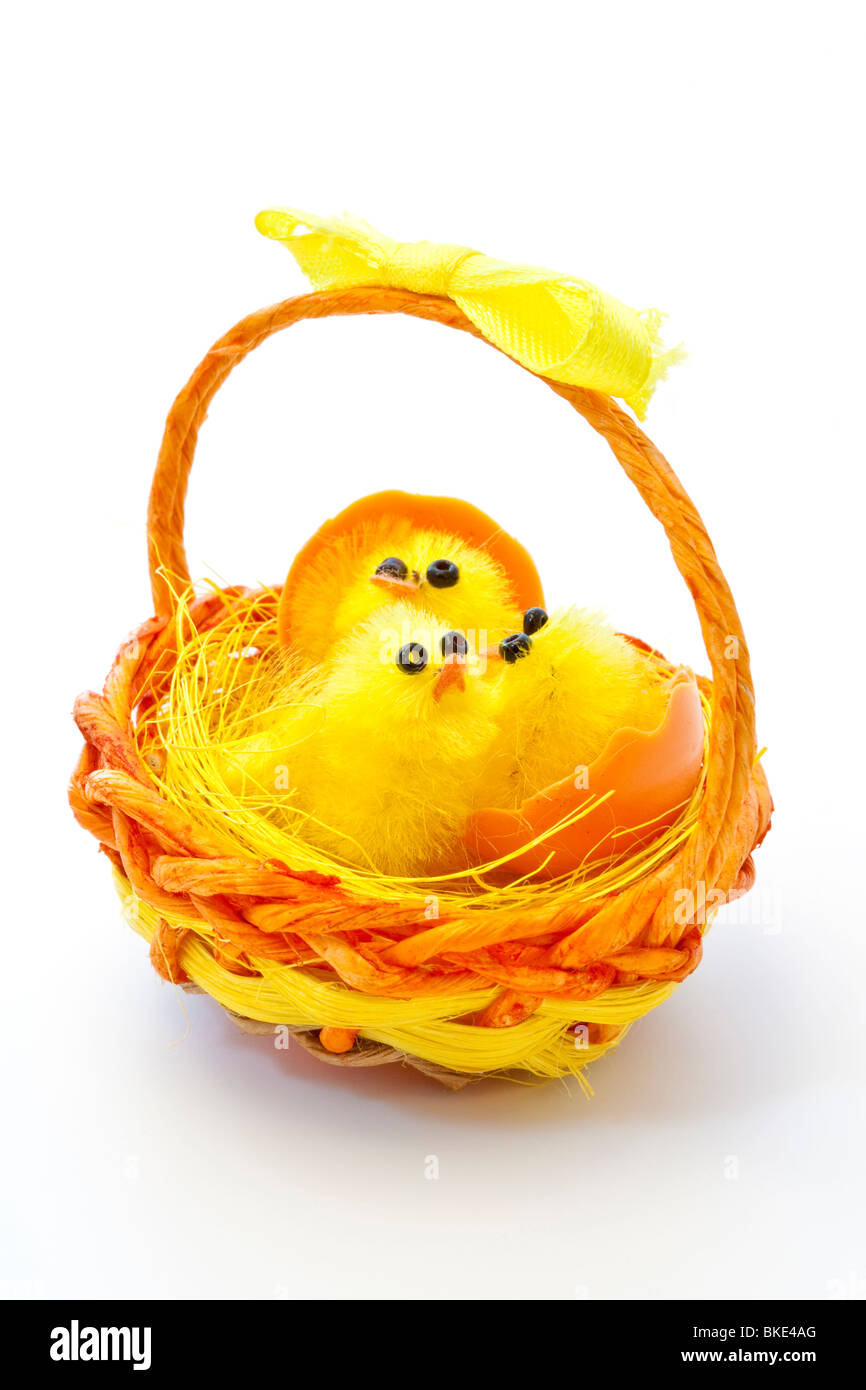 Toy easter chicks in basket Stock Photo