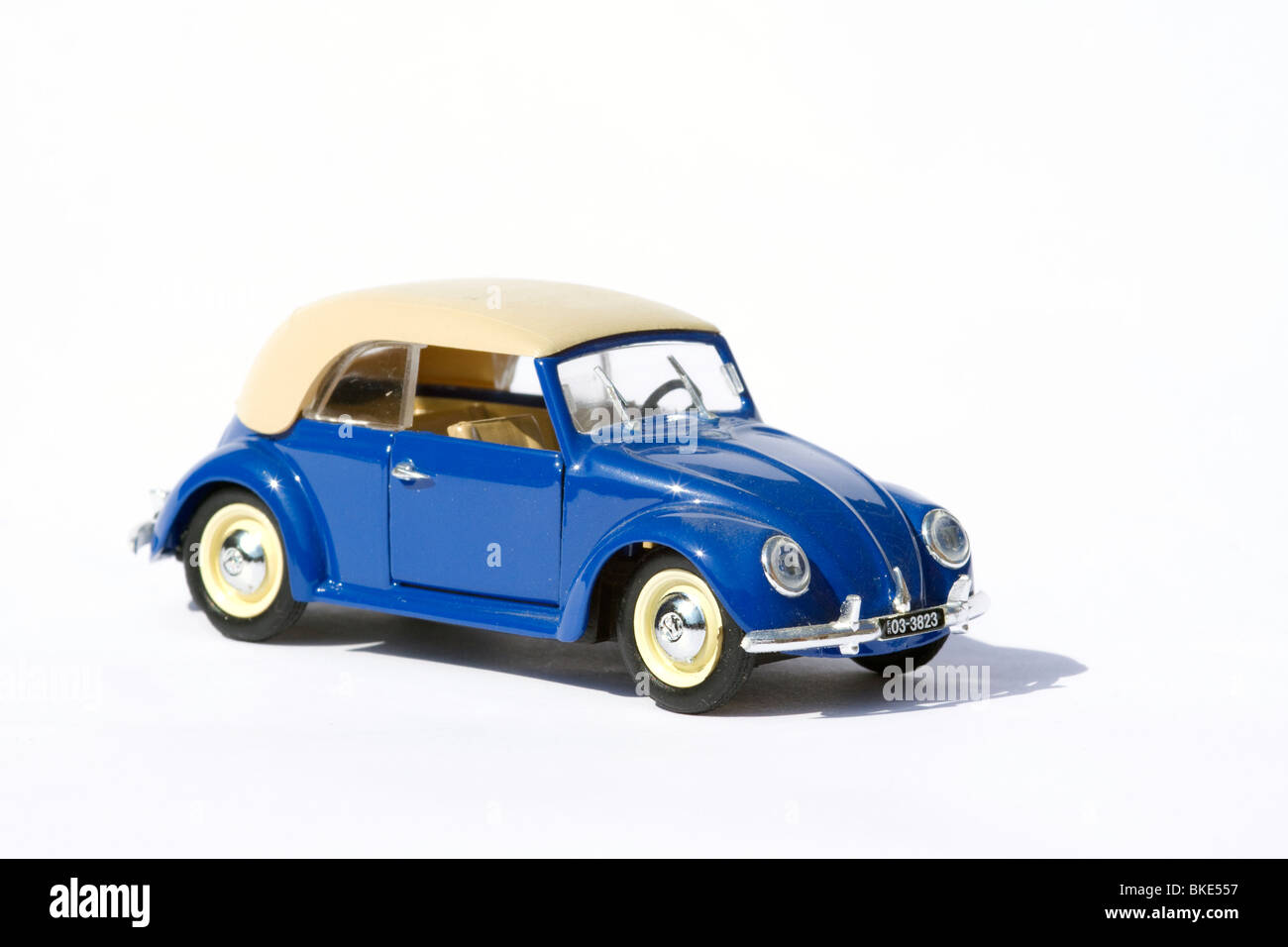 Children's collectible model of a volkswagen toy convertible beetle on white background - Stock Image