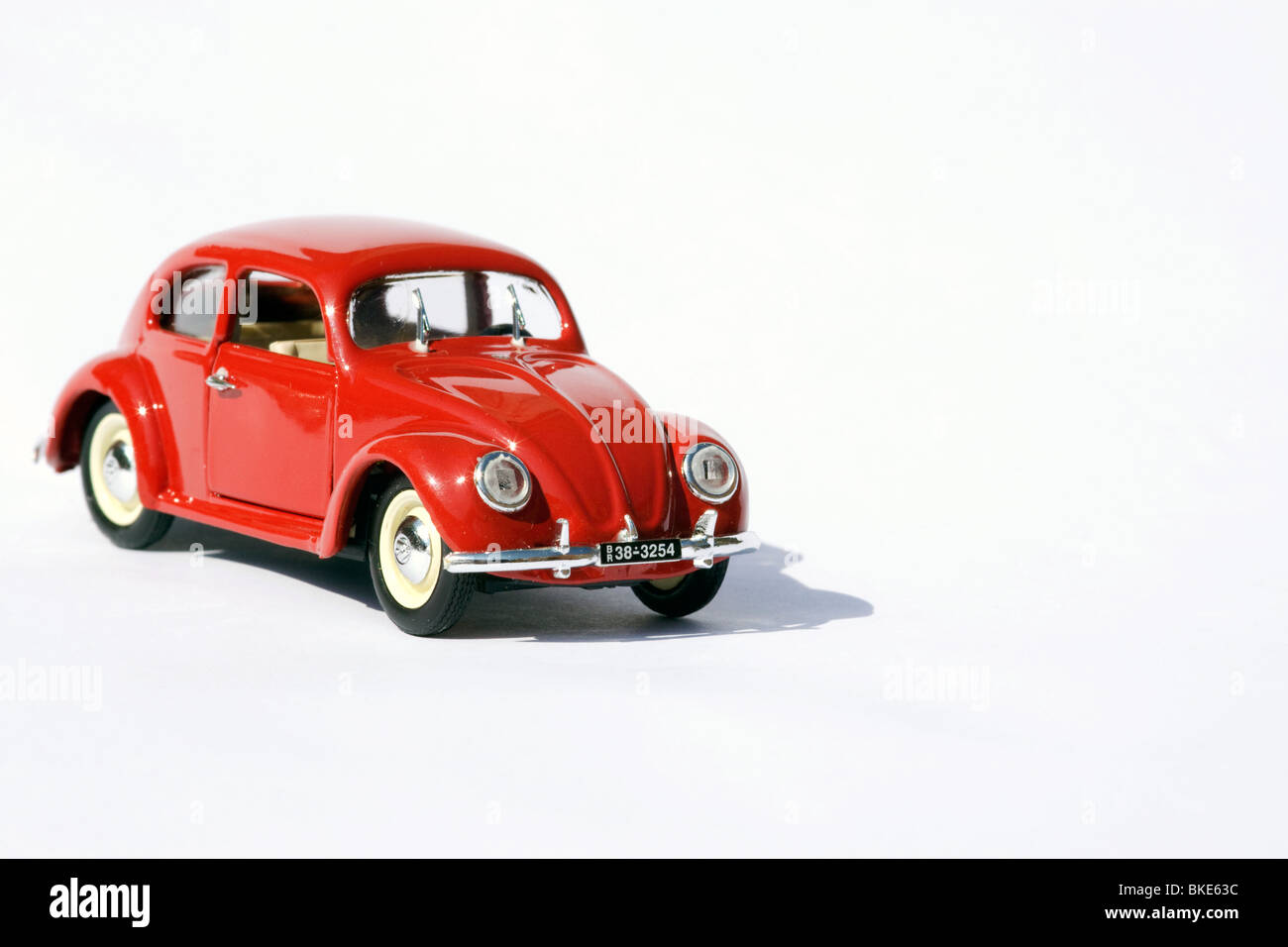 Collectible die cast toy model of a volkswagen beetle on white background - Stock Image