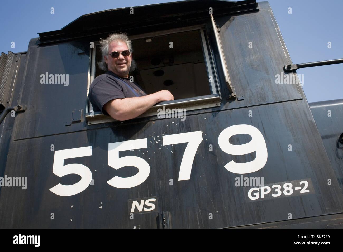 CSX locomotive engineer aka engineman, Hagerstown, Maryland - Stock Image