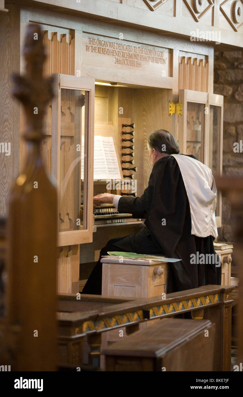 church organ organist music playing player organs musical worship worshiping religious religion musical instrument - Stock Image