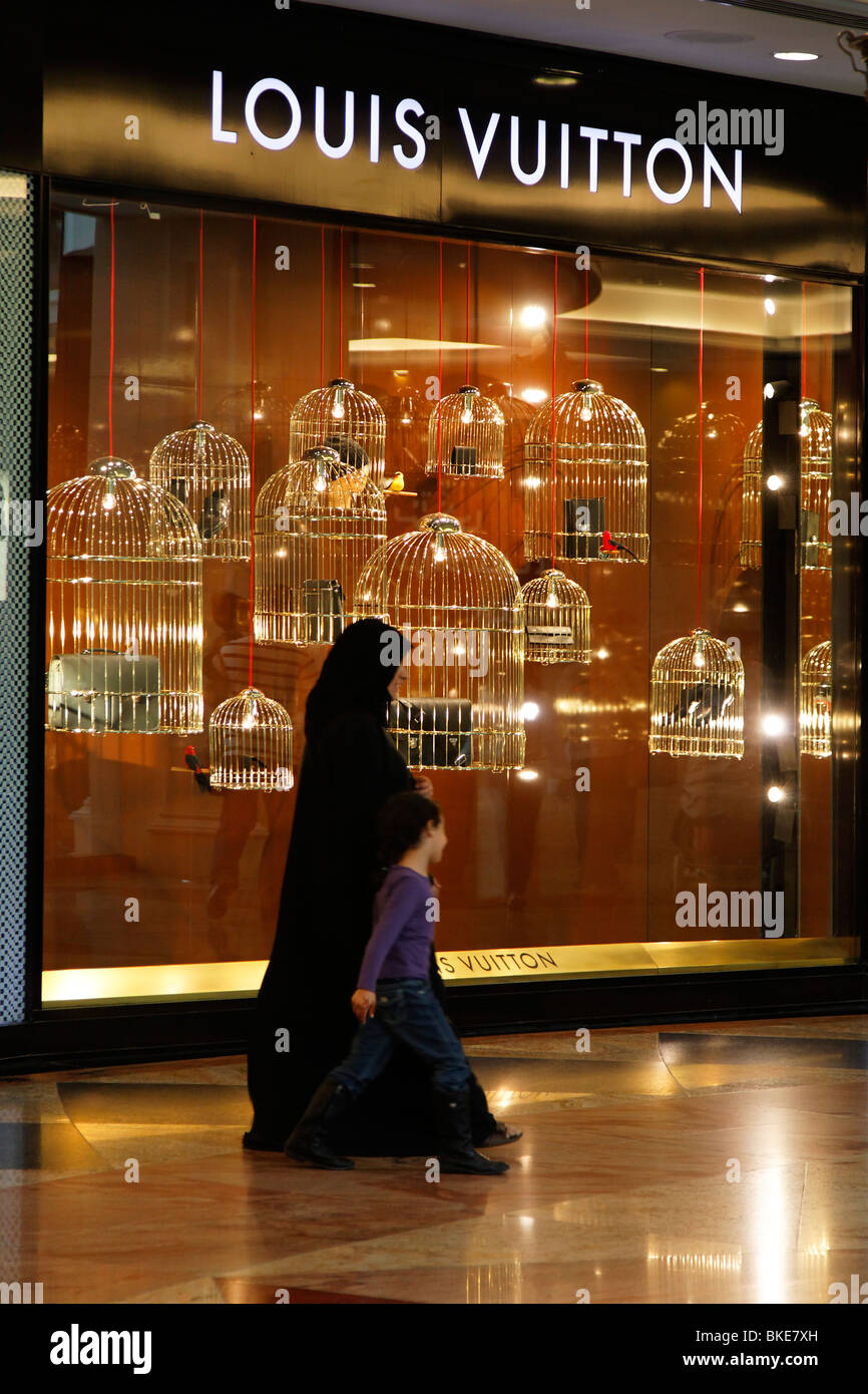 Arabian women at Mall of Emirates , Louis Vuitton shop, shopping mall , Dubai, Stock Photo
