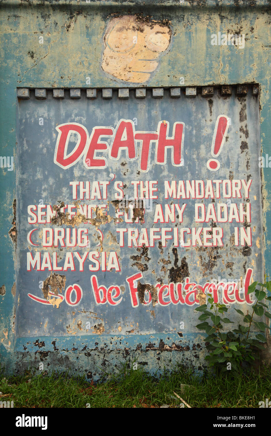 Anti drug trafficking sign on the walls of the old prison by Hang Tuah monorail station, Kuala Lumpur, Malaysia - Stock Image