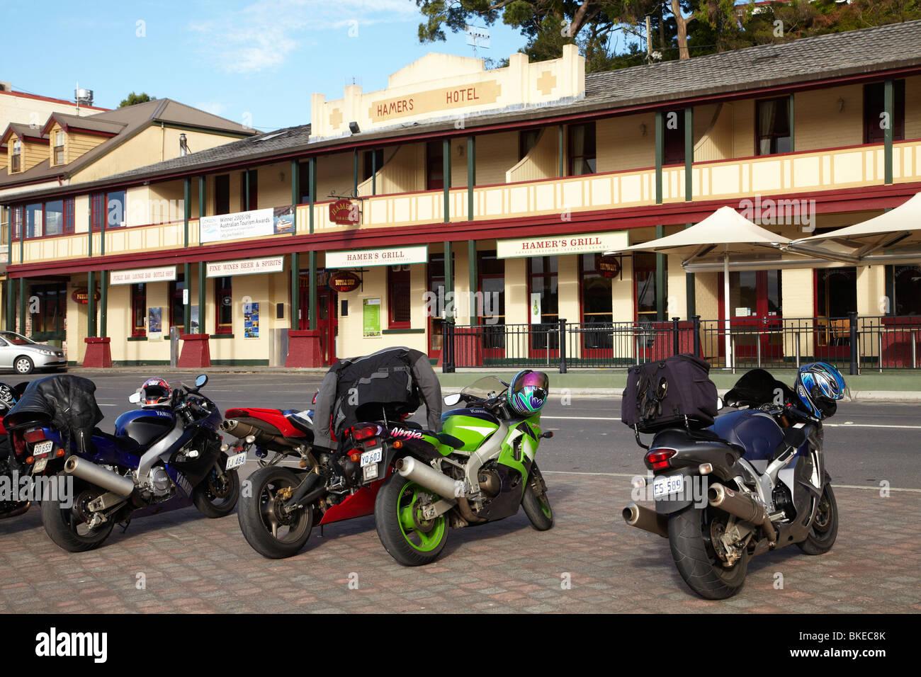 Motorbikes and Hamers Hotel, Esplanade, Strahan, Western Tasmania, Australia - Stock Image