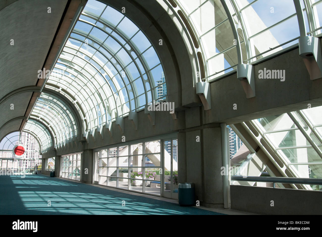 Natural light shining through curved glass ceiling in hallway in San Diego Convention Center, California - Stock Image