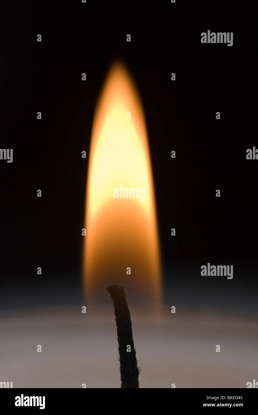 single flame of a candle - Stock Image