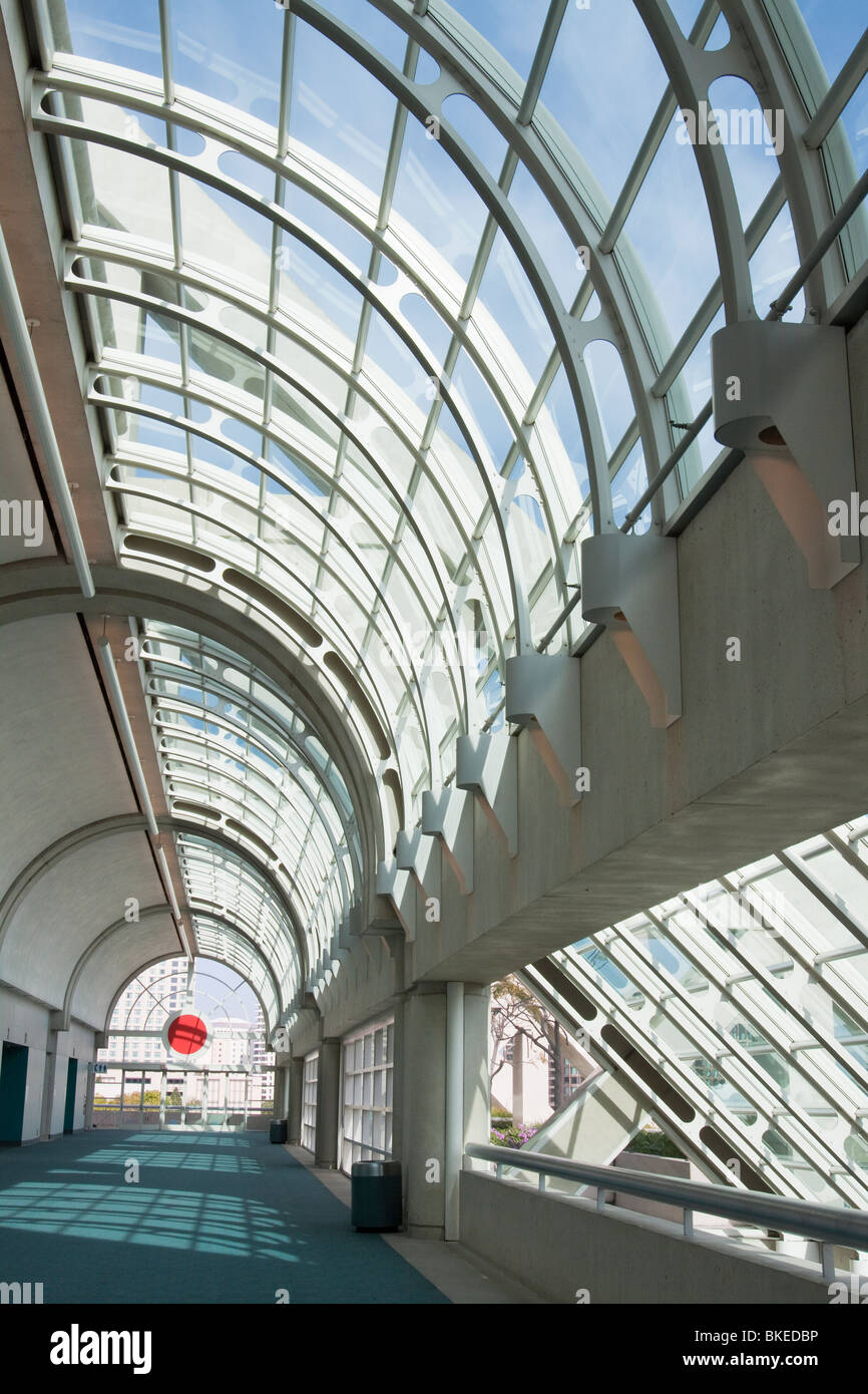 Curved glass ceiling over hallway in San Diego Convention Center - Stock Image
