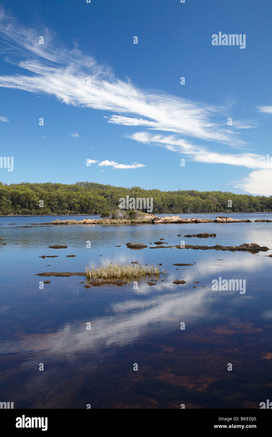 Reflections by Sarah Island (Historic Convict Station), Maquarie Harbour, Western Tasmania, Australia - Stock Image