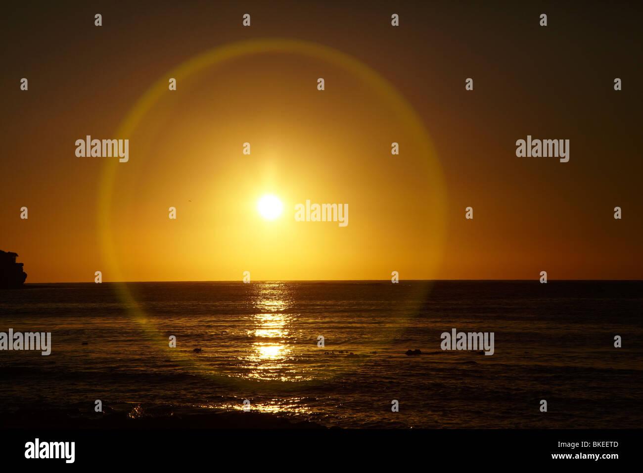 Lens Flare at Sunrise, Eaglehawk Neck, Tasman Peninsula, Southern Tasmania, Australia - Stock Image