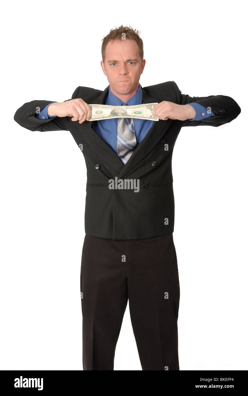 Man stretching a dollar. - Stock Image