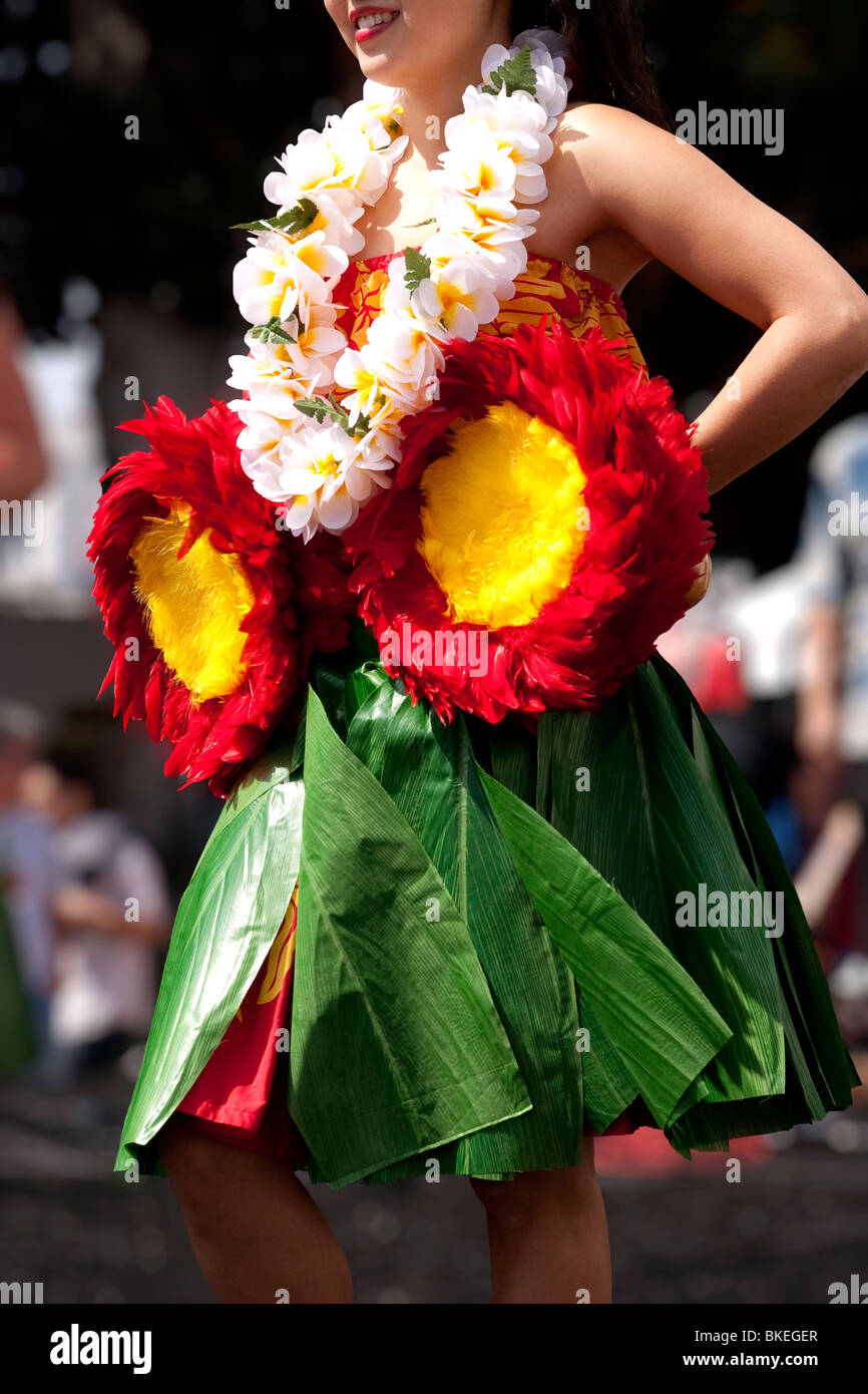 Hula Dancer with Lei and Hawaiian pom poms - Stock Image