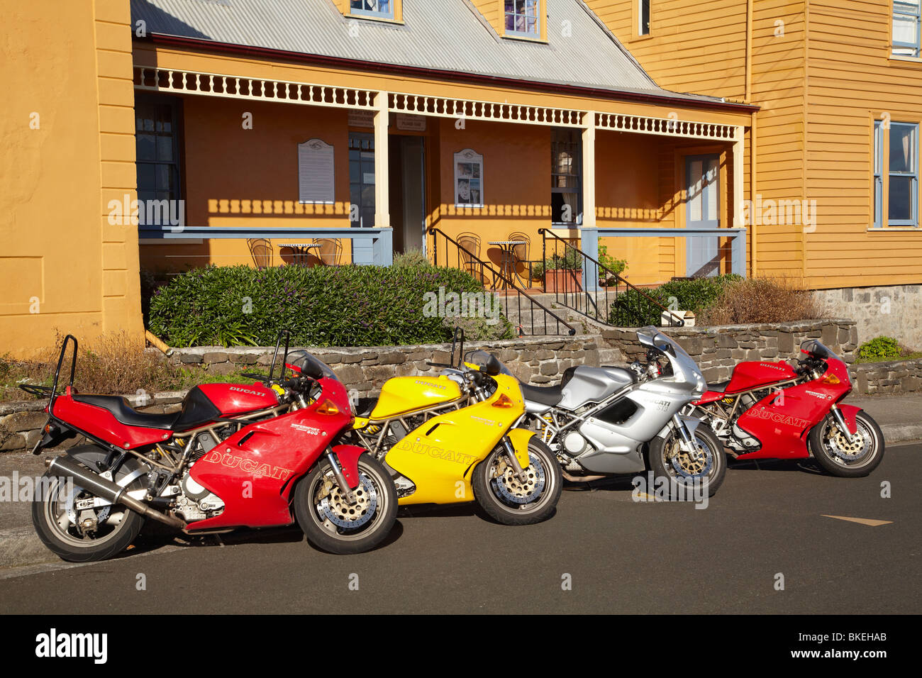 Four Ducati Motorbikes, and The Bay View Guesthouse, Alexander Terrace, Stanley, Northwest Tasmania, Australia - Stock Image