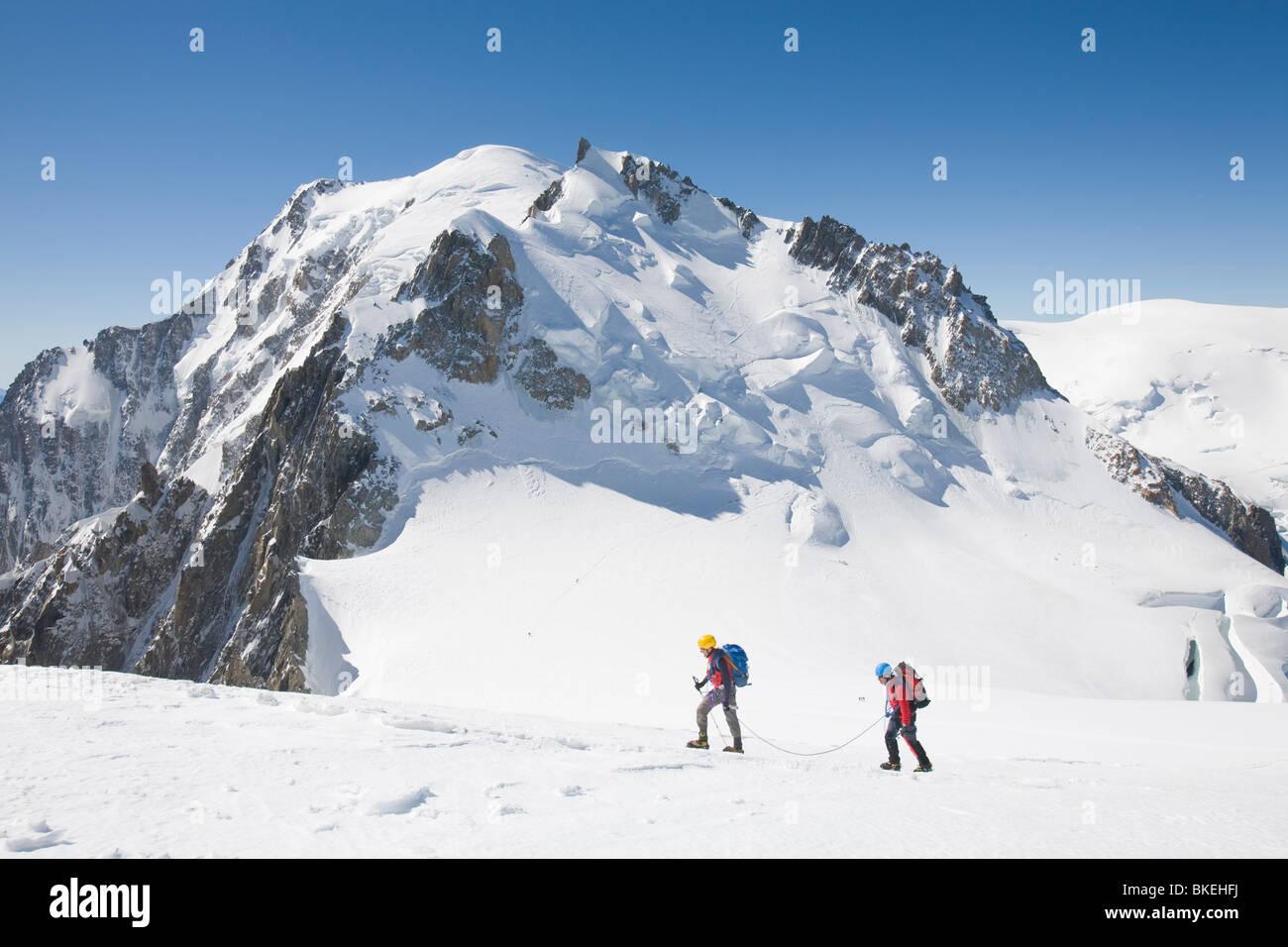 Climbers nearing the summit of the 4000 metre peak of Mont Blanc Du Tacul above Chamonix France Stock Photo