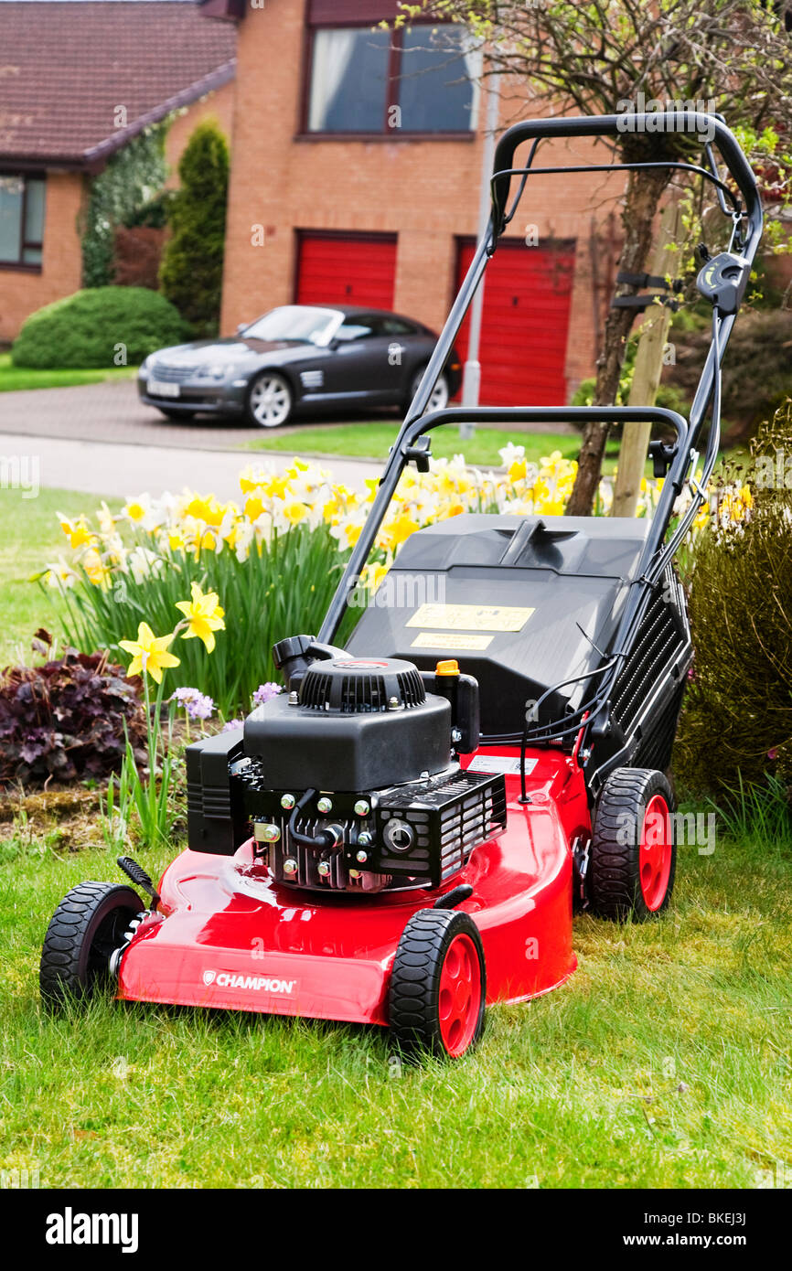 A Champion petrol lawn mower ready for the first grass cut of the year. - Stock Image