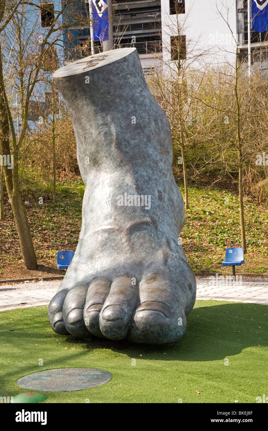 A sculpture made from a cast of Uwe Seeler's foot outside of Hamburg Arena, the home stadium of Hamburger Sport - Stock Image