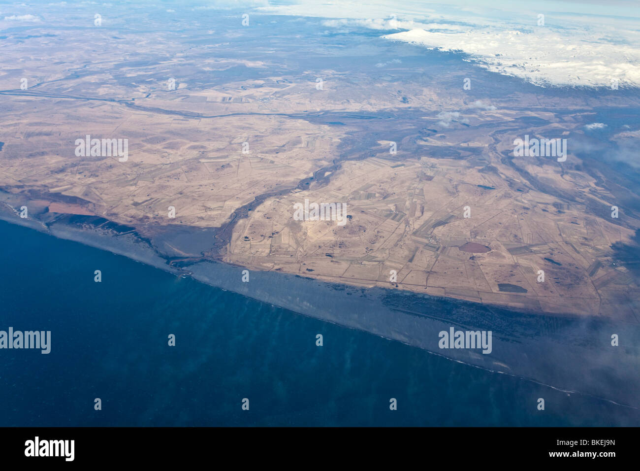 Aerial of Iceland southern coast with Markarfljot river and sand being blown from Landeyjarsandur black sandy beach - Stock Image