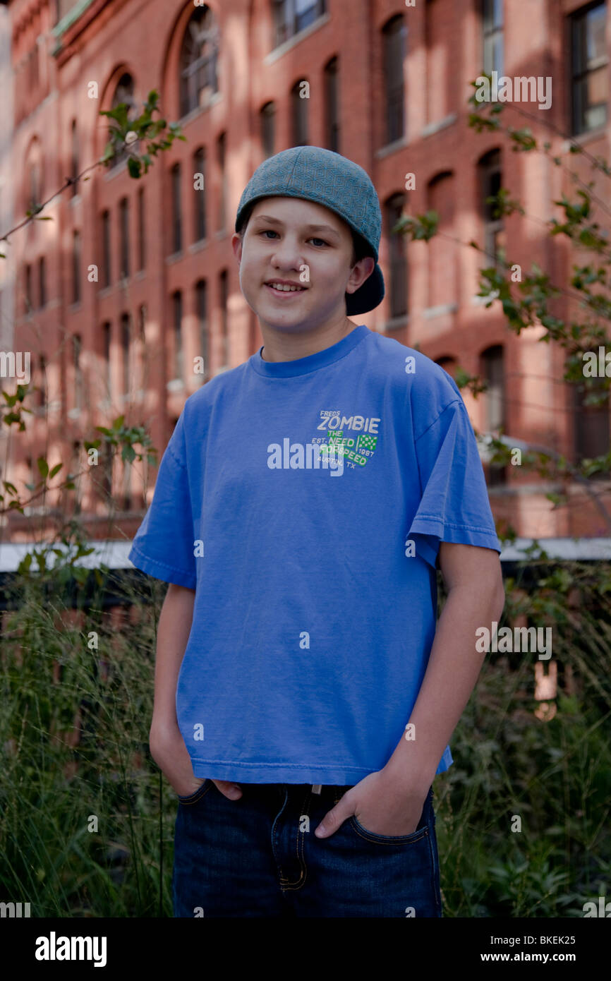 Portrait of 13 year old boy in the Highline Park, NYC - Stock Image