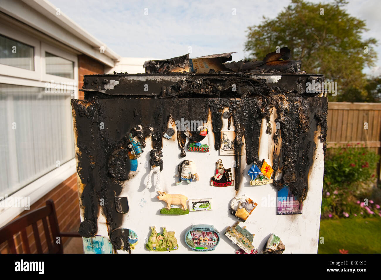 Domestic fridge freezer melted and burnt following fire caused by electrical control panel fault - Stock Image