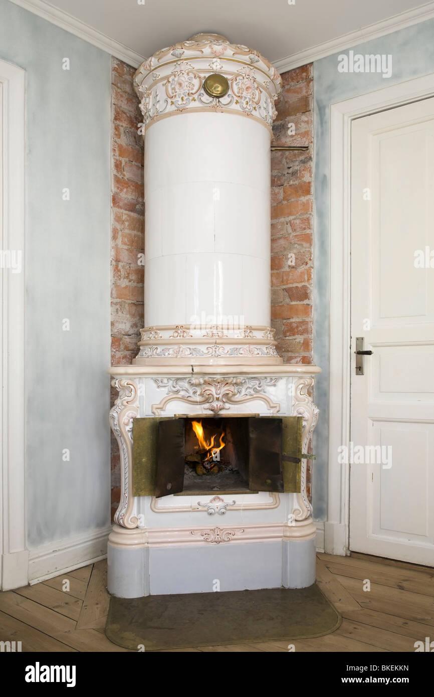 Late 19th century Swedish tiled stove. - Stock Image