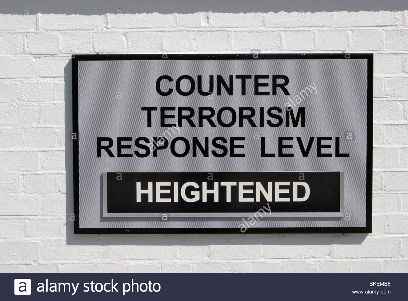 Portsmouth UK Portsmouth Historic Dockyard Sign stating the Counter Terrorism Response Level is heightened. - Stock Image