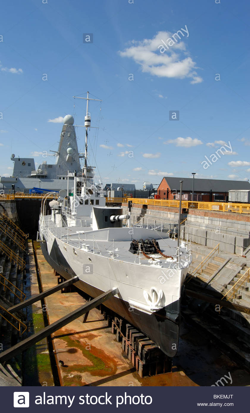Portsmouth UK Portsmouth Naval Dockyard WWI warship M33 in a dry dock - Stock Image
