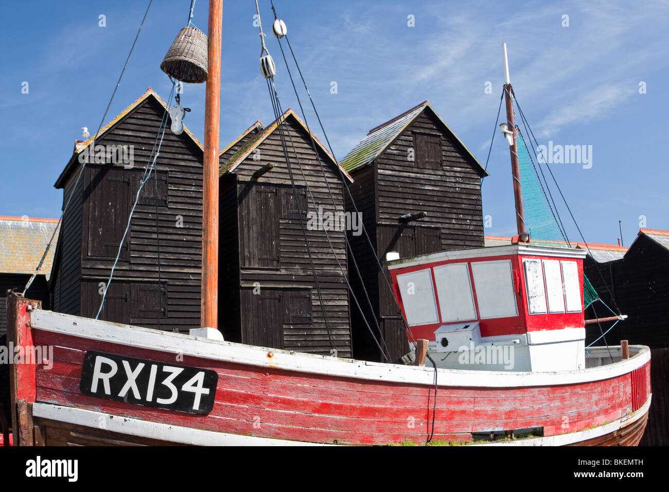 Harbour in hastings, uk. Boats among historic net huts in ...