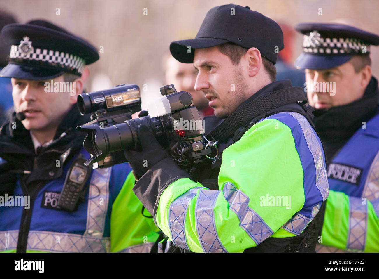 Police photographer photographing protestors at a climate change rally in London December 2008 - Stock Image