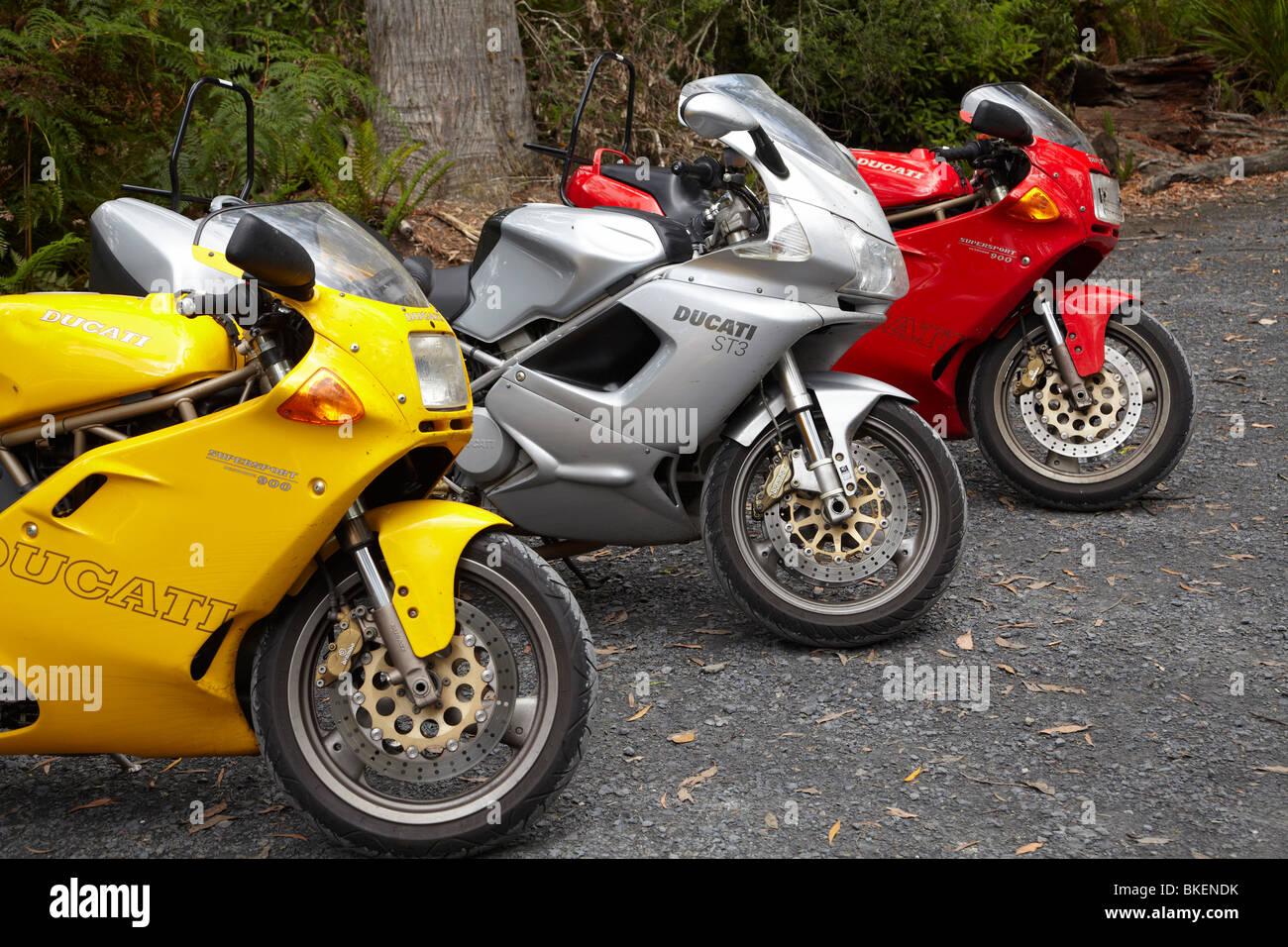 Three Ducati Motorbikes, Bass Highway, Northwest Tasmania, Australia - Stock Image