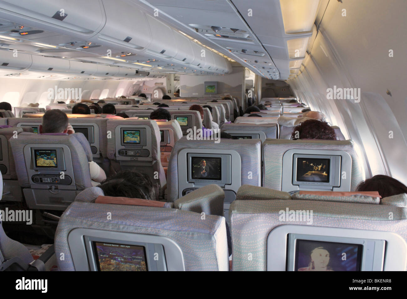 Air travel and tourism. Economy class seating in a long-haul airliner - Stock Image