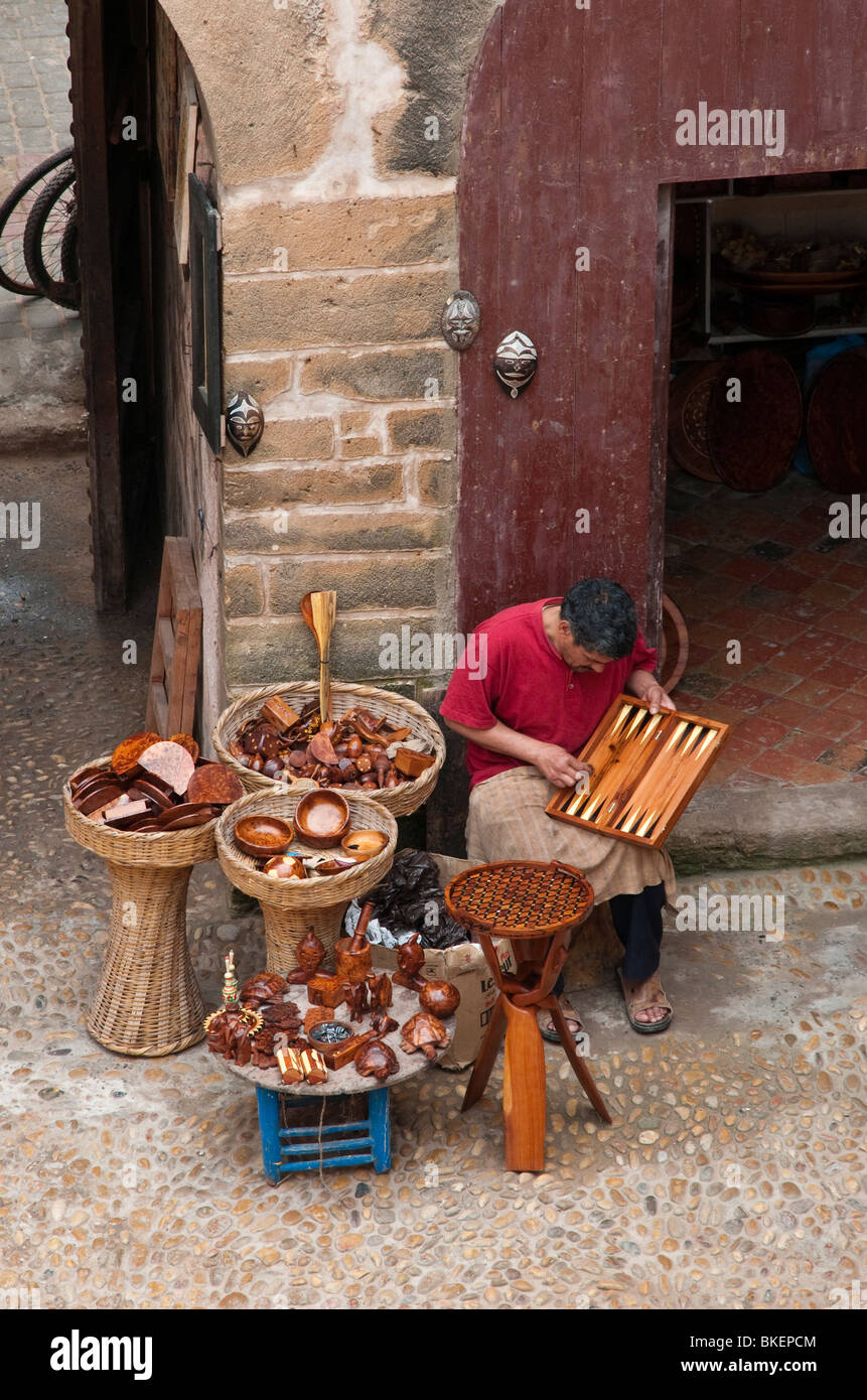 Artisan outside his shop in Essaouira, Morocco - Stock Image