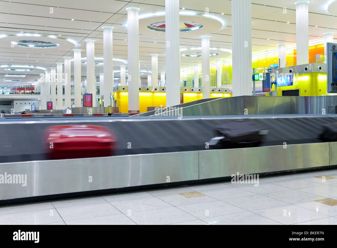 UAE, United Arab Emirates, Dubai, Dubai International Airport, Terminal 3, Baggage Carousel in the Arrivals Hall - Stock Image