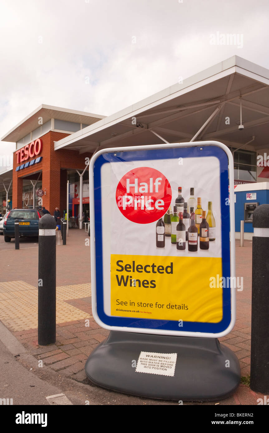 A sign advertising half price wines at the Tesco Superstore in Beccles , Suffolk , England , Great Britain , UK - Stock Image