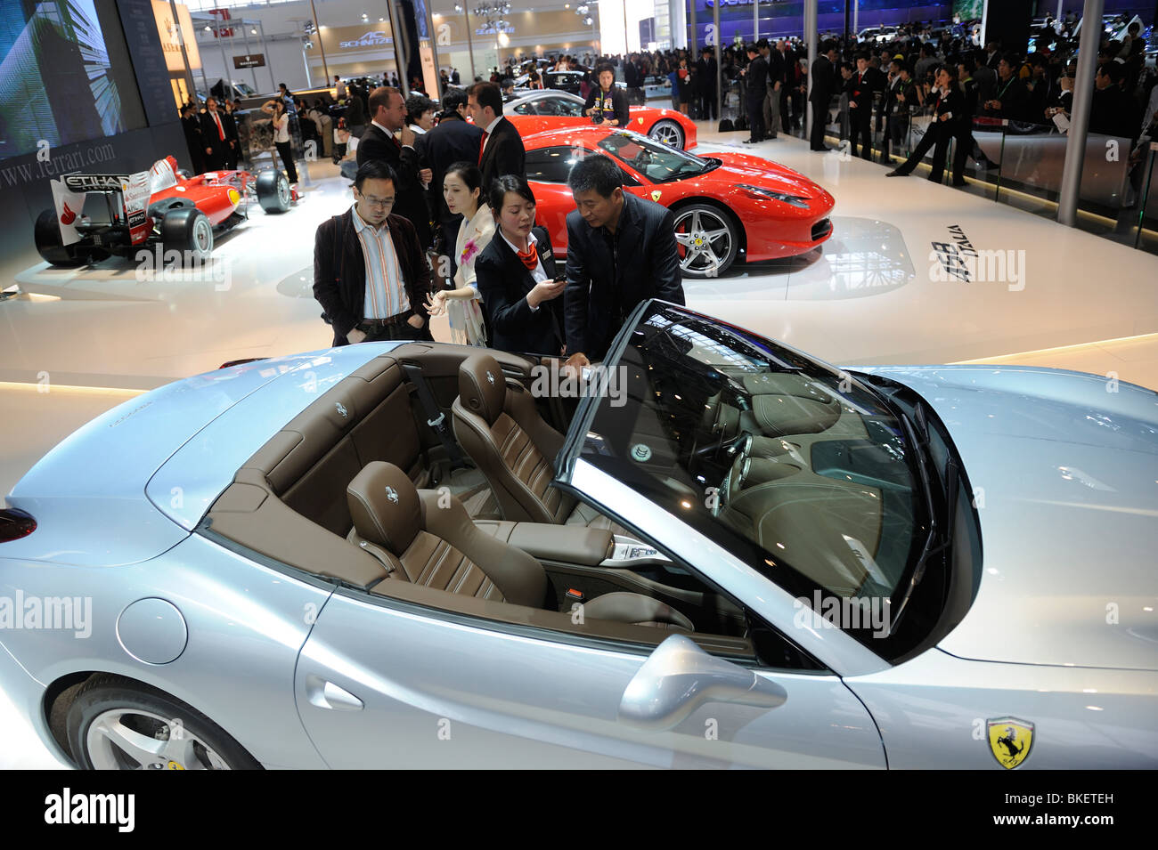 Potential buyers at Ferrari stand during the Beijing Auto Show. 23-Apr-2010 - Stock Image