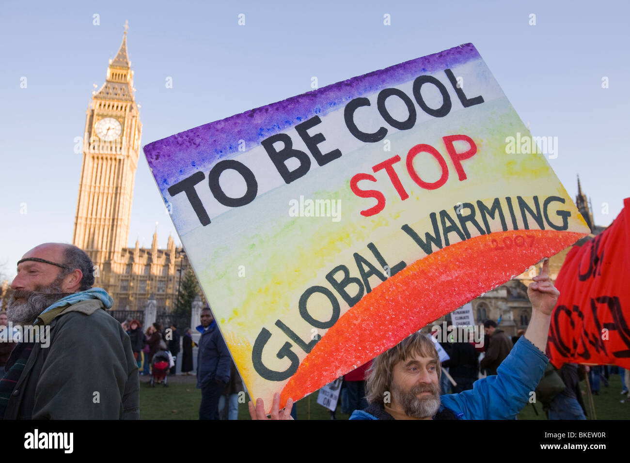 Protestors at a climate change rally in Parliament Square London December 2008 with Big Ben behind - Stock Image
