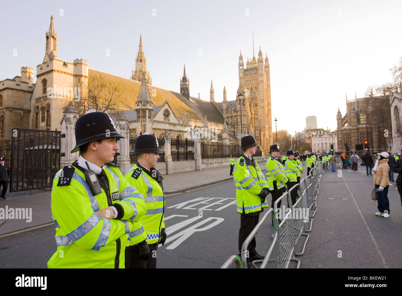 Police protecting the House of Parlaiment from climate change protestors on a rally in Parliament Square in December - Stock Image