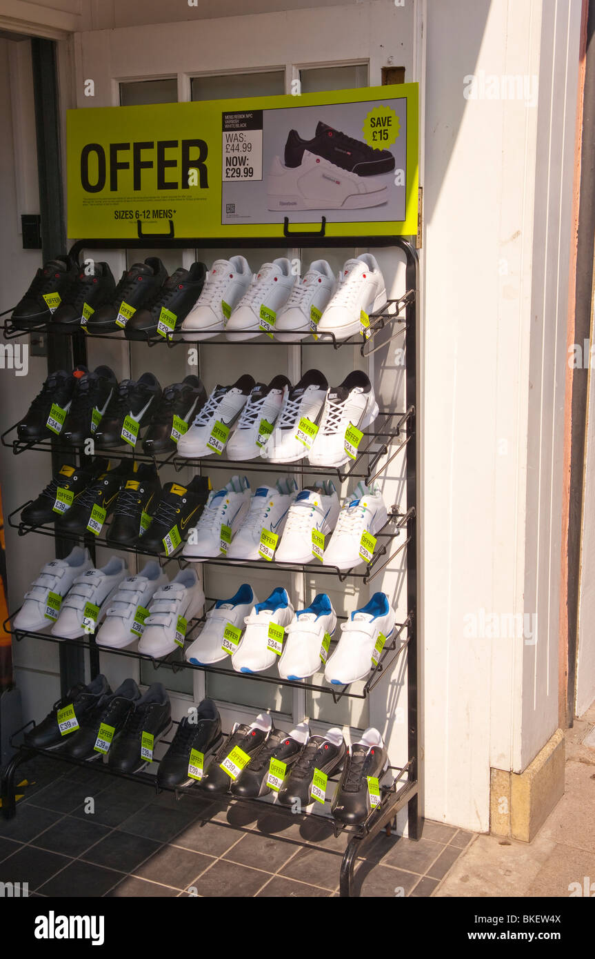 5b07f566056 Training shoes for sale outside a sports shop store in England