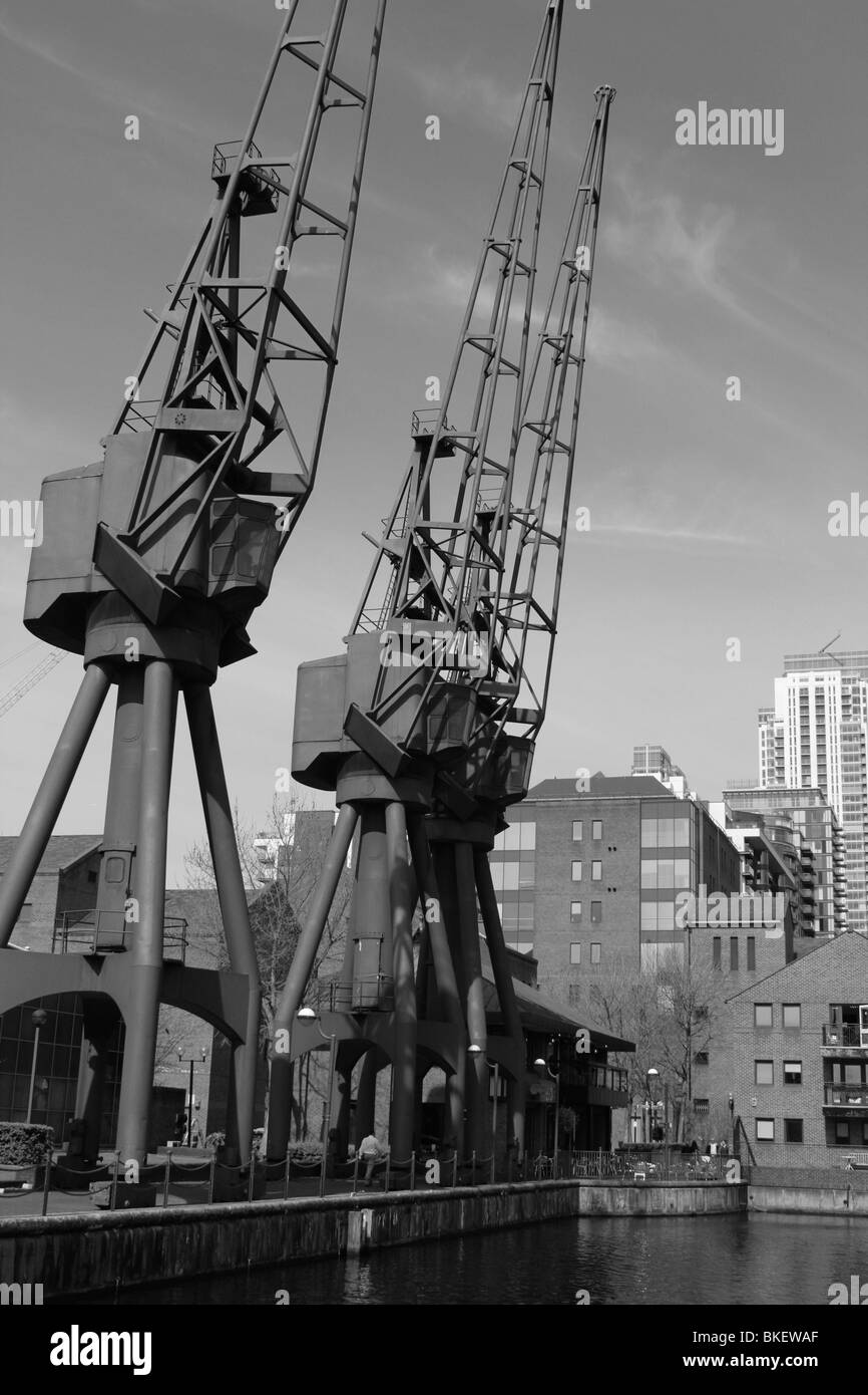 old cranes millwall inner dock canary wharf london docklands england uk gb - Stock Image