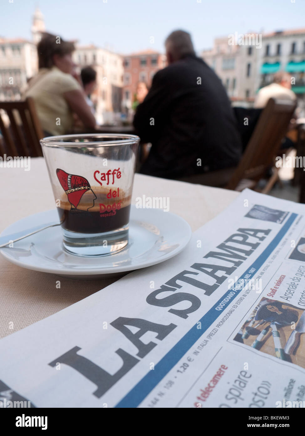 Detail of Italian newspaper and coffee at typical cafe in Venice Italy - Stock Image